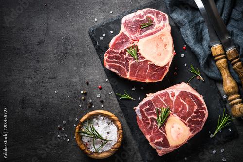 Door stickers Meat Raw beef steak osso bucco on black. Marble meat.