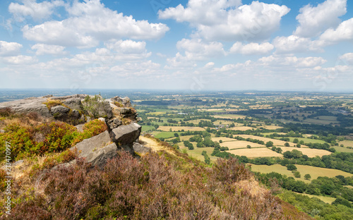Rocky outcrop at Bosley cloud in cheshire with view over the plains Fotobehang