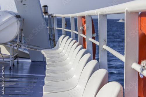 Carta da parati Horizontal shot of ferry white one line plastic sealing under open blue sky back