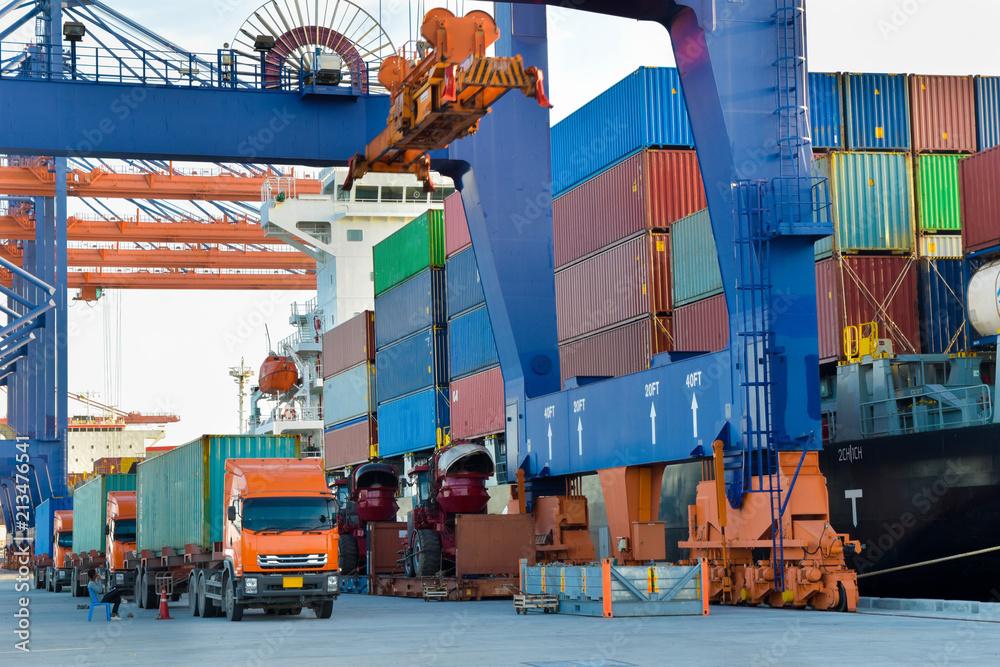Fototapeta Port activities, big container ship discharging and loading at port terminal