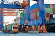 Leinwandbild Motiv Port activities, big container ship discharging and loading at port terminal