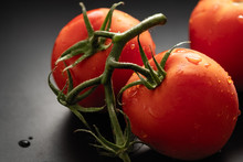 Natural Red Tomatoes, Cherry Tomatoes On A Wooden Background