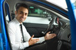 Sales man is sitting in new car