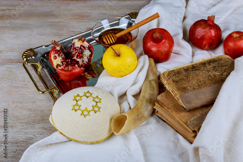 Honey, apple and pomegranate for traditional holiday symbols rosh hashanah jewesh holiday on wooden background.