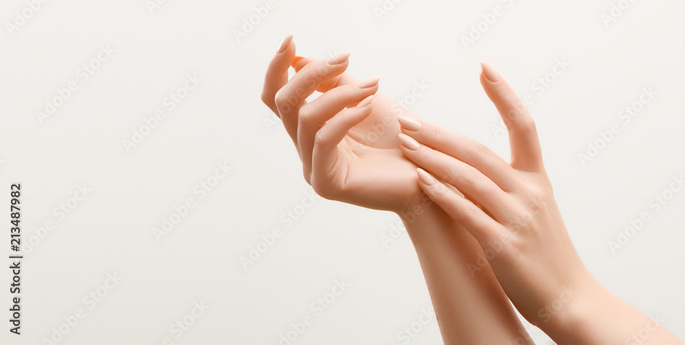 Fototapety, obrazy: Beautiful Woman Hands. Female Hands Applying Cream, Lotion. Spa and Manicure concept. Female hands with french manicure. Soft skin, skincare concept. Hand Skin Care.