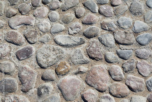 Fotografía Grey cobblestone texture of a ground with many stones