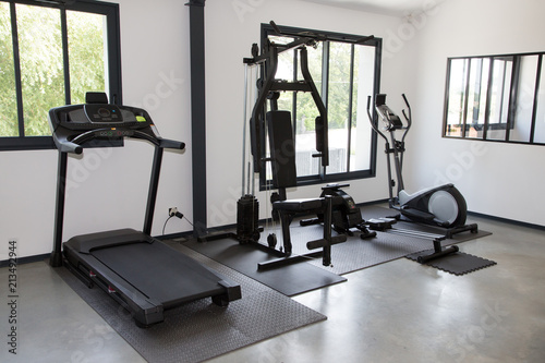 Private gym at home interior with different sport exercise equipment Wallpaper Mural