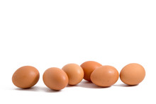 Six Eggs In A Row On White Background