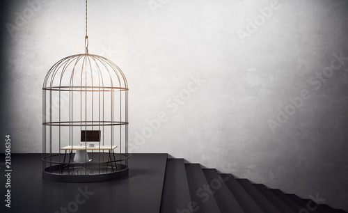 Photo  birdcage with workplace and stairs