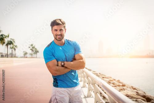 Fototapeta Sportive man training outdoors obraz na płótnie