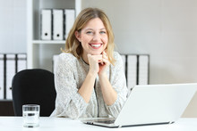 Satisfied Employee Looking At Camera At Office