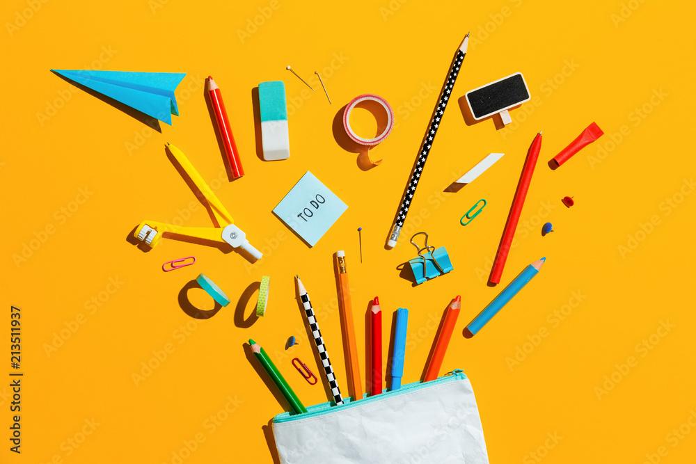 Fototapeta School supplies and pencil case. Back to school concept.