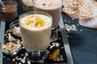 milkshakes with chocolate and mango in glasses
