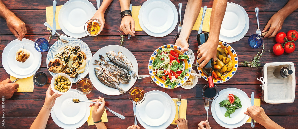 Fototapety, obrazy: Big family dinner. Top vertical view on the table with dishes and hands