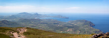 Summer View Looking West From Summit Of Mount Brandon Towards Smerwick Harbour, Sybil Head And The Blasket Islands In County Kerry, Ireland.