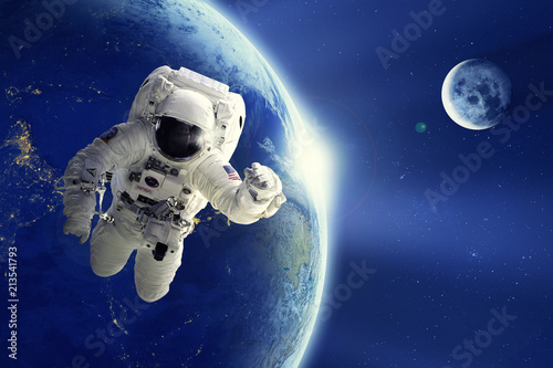 Keuken foto achterwand Nasa Astronaut or Spaceman floating in space with Earth planet and moon background. Element of this image provided by NASA