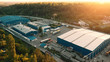 Aerial view of warehouse storages or industrial factory or logistics center from above. Aerial view of industrial buildings at sunset