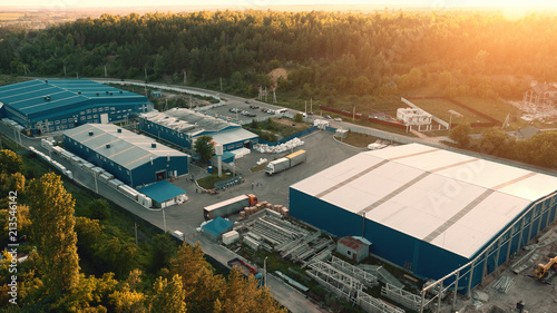 Photo Aerial view of warehouse storages or industrial factory or logistics center from above