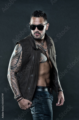 82a55f641 Tattooed man with six pack and ab. Bearded man with tattoo on chest and  arms. Tattoo model with beard on unshaven face. Fashion style and trend.