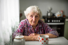 An Elderly Russian Woman Sitti...