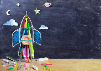 Fototapeta Startup - Rocket Drawing With School Supplies On Table