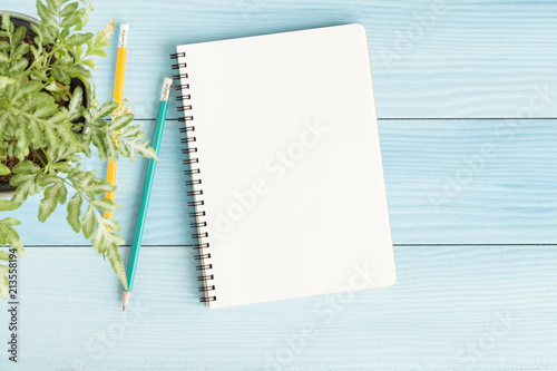 Obraz Blank notebook with and pencil on blue background,Flat lay photo of notebook for your message - fototapety do salonu