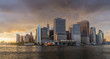 Panorama view of NYC Lower Manhattan skyline with sailboat passing by in New York Harbor