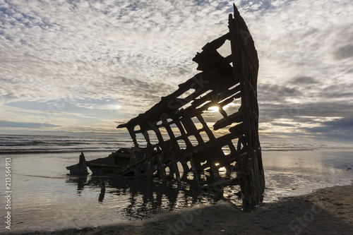 Silhouette of the Peter Iredale shipwreck. Canvas Print