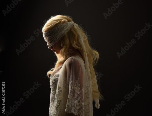 portrait of blonde girl wearing a white lace dress and blindfold Wallpaper Mural