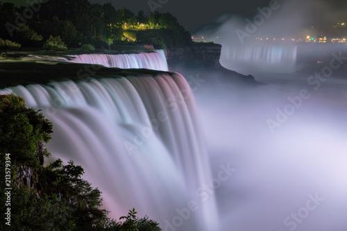 Wall Murals Waterfalls Niagara Falls lit at night by colorful lights, Niagara Falls, NY, USA