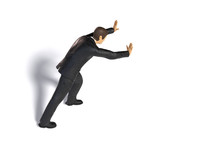 Toy Miniature Businessman Pushing, Figurine Concept Isolated With Shadow On White Background