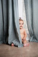 Cute Baby Girl Playing Peekabo...