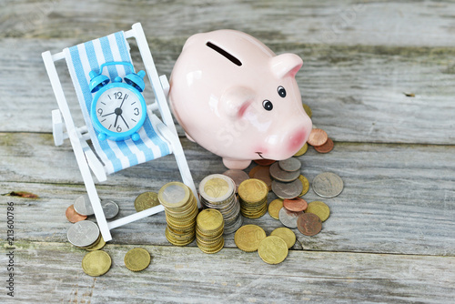Fotografía  Time to invest your savings concept with pile of money , alarm clock and piggy b
