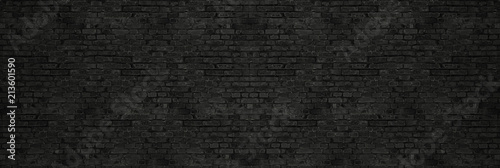 Poster Brick wall Vintage Black wash brick wall texture for design. Panoramic background for your text or image.