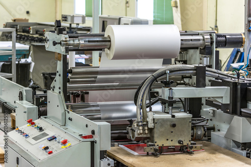 Matte or gloss plastic machine in a printing press for a perfect finish of printed documents Poster