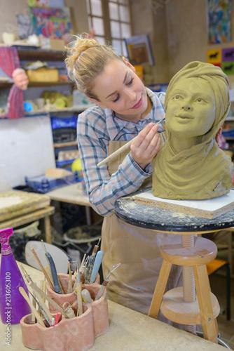Female artist working on sculpture