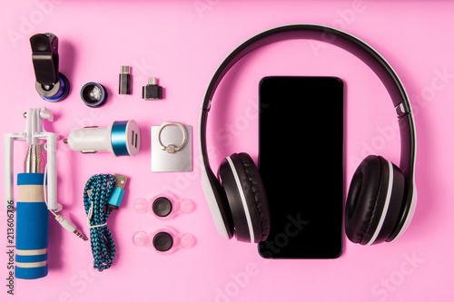 Fototapeta Headset listen music with mobile phone and Accessory set technology Blank space on bright pink background obraz