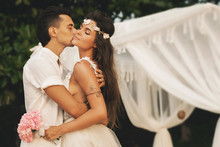 Beautiful Married Couple Is Celebrating Their Wedding On The Beach