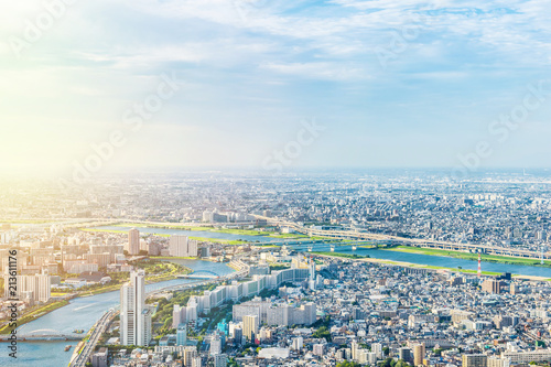 Photo Stands Tokyo Asia Business concept for real estate and corporate construction - panoramic modern city urban skyline bird eye aerial view under sun & blue sky in Tokyo, Japan