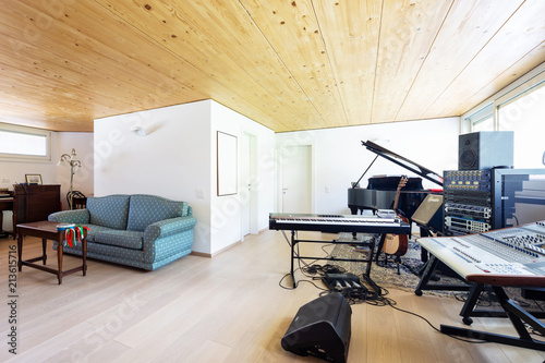 Study of musician in a modern villa and lots of wood - 213615716