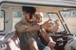 Man taking selfie with friend in van
