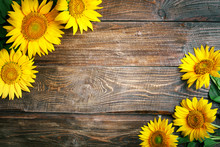 Beautiful Sunflowers On A Wood...