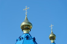 Blue Roofs Of Russian Orthodox Church Against Clear Blue Sky. Cathedral Of Our Lady Of Kazan In Komsomolsk-on-Amur In Russia