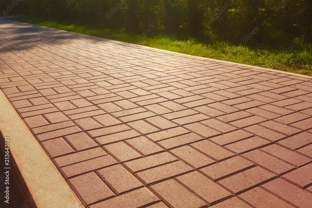 Fototapeta Red cobblestone footpath