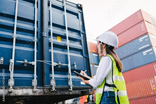 Fotografía  woman staff checking container box for logistic export and import