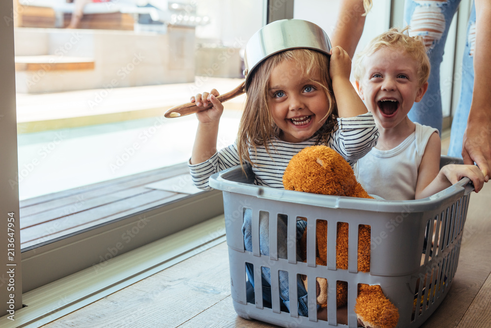 Fototapety, obrazy: Kids rides in a laundry basket