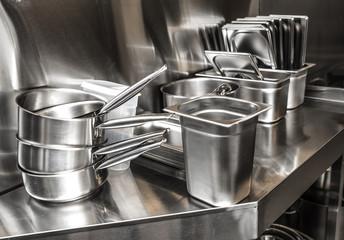 Steel pots on steel background
