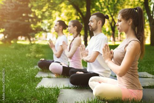 Obraz Group of people meditating in park - fototapety do salonu