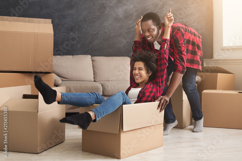 Young black couple unpacking moving boxes Canvas Print