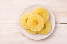 Top View Of Canned Pineapple Slices On Plate